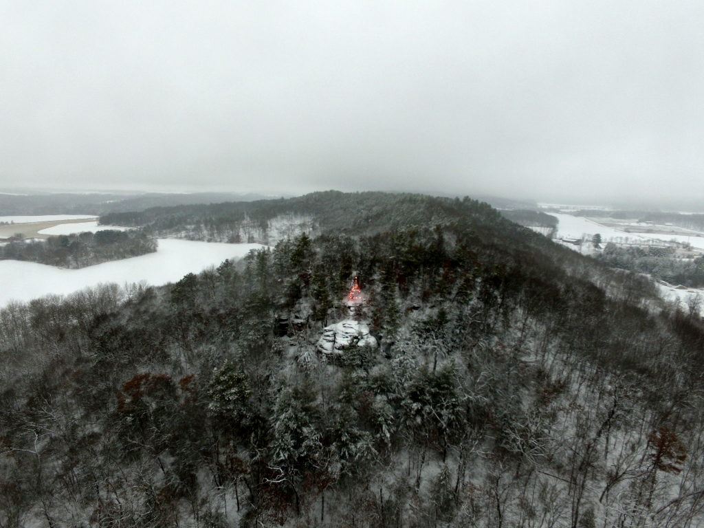 aerial view of christmas tree on bluff