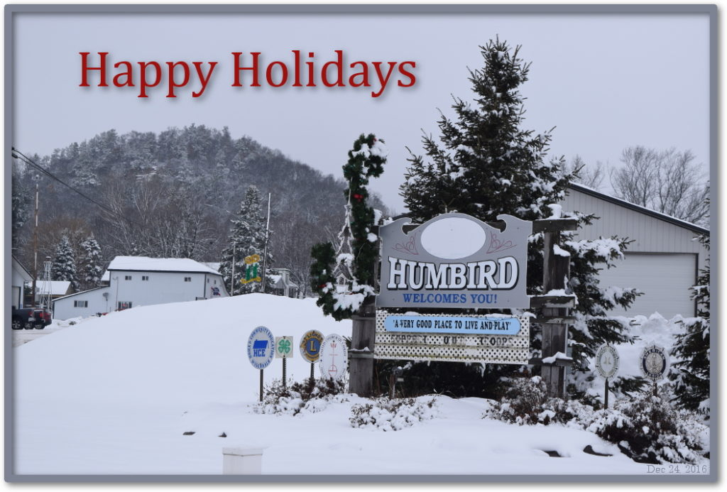 Picture of the Humbird Wisconsin sign with bluff in the background